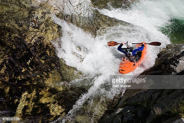 Kayaker going down waterfall