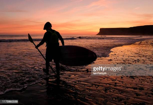 A kayaker heads out to sea as the sun rises over the beach on September 20 2019 in Saltburn By The Sea England Much of the country will be dry and...