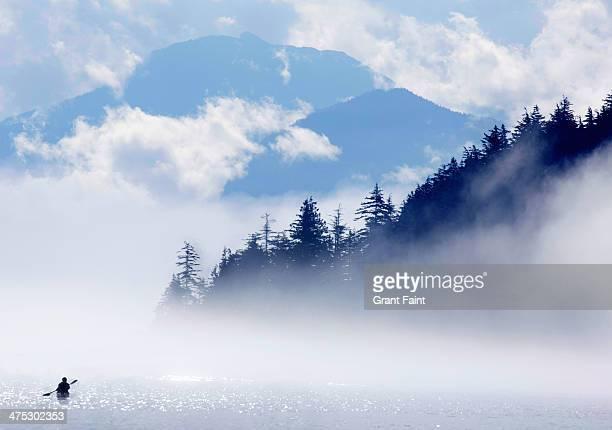 kayaker in ocean fog - sea kayaking stock pictures, royalty-free photos & images