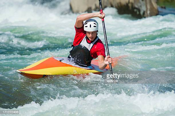 Kayaker in red dress