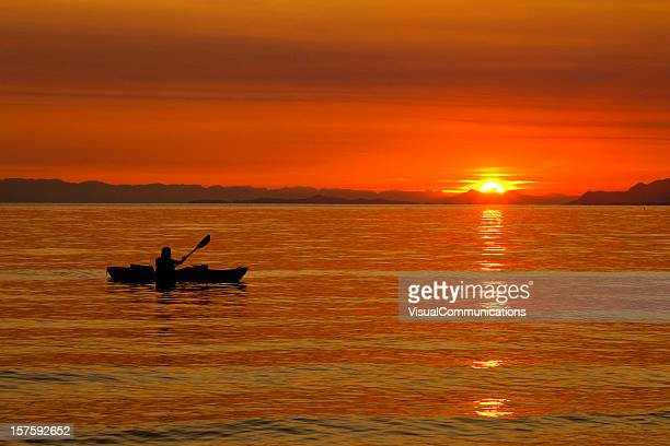 kayaker in sunset.