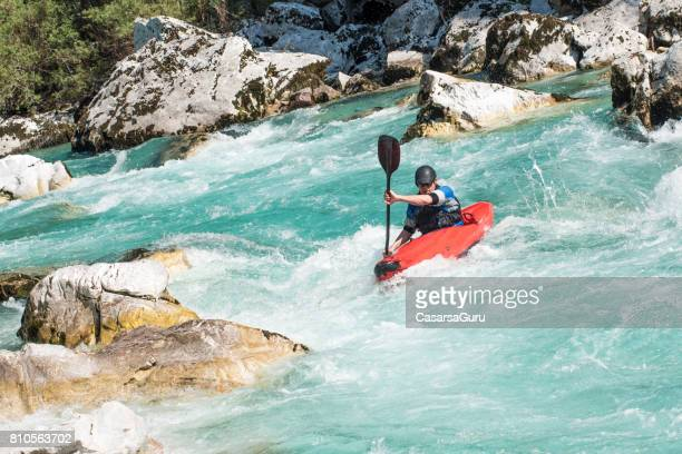 kayaker in white water's of river soca - rapid stock pictures, royalty-free photos & images