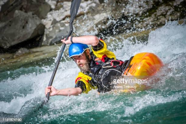kayaker on river soča - slowenien stock-fotos und bilder