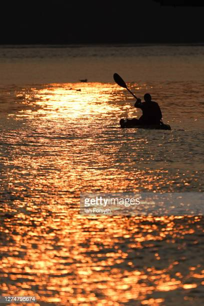 Kayaker paddles along the coastline on the first day of Autumn at Saltburn beach on September 22, 2020 in Saltburn By The Sea, England. The autumnal...