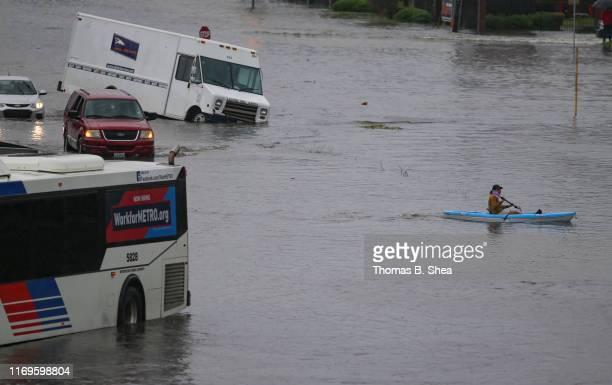 A kayaker paddles though the flooded street of Little York on September 19 2019 in Houston Texas Gov Greg Abbott has declared much of Southeast Texas...