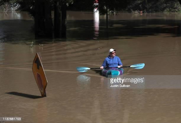A kayaker paddles through a flooded neighborhood on February 28 2019 in Guerneville California The Russian River has crested over flood stage and is...