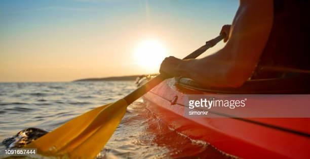 kayaker rowing in sea - kayak stock pictures, royalty-free photos & images