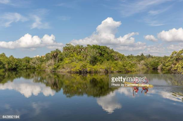 kayakers at lovers key state park - lee county florida stock photos and pictures