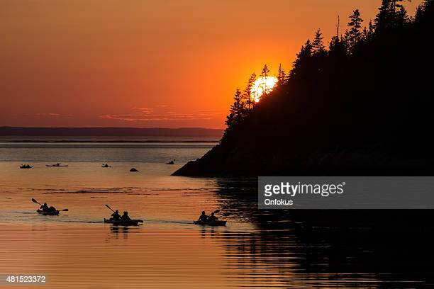 kayakers at sunset - river st lawrence stock pictures, royalty-free photos & images