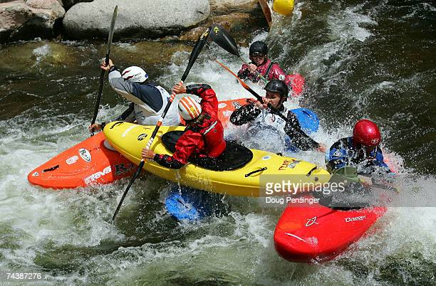 Kayakers collide during the 8 Ball Kayak Sprint during the 8 Ball Kayak Sprint during the Teva Mountain Games June 3, 2007 Competitors, in white...
