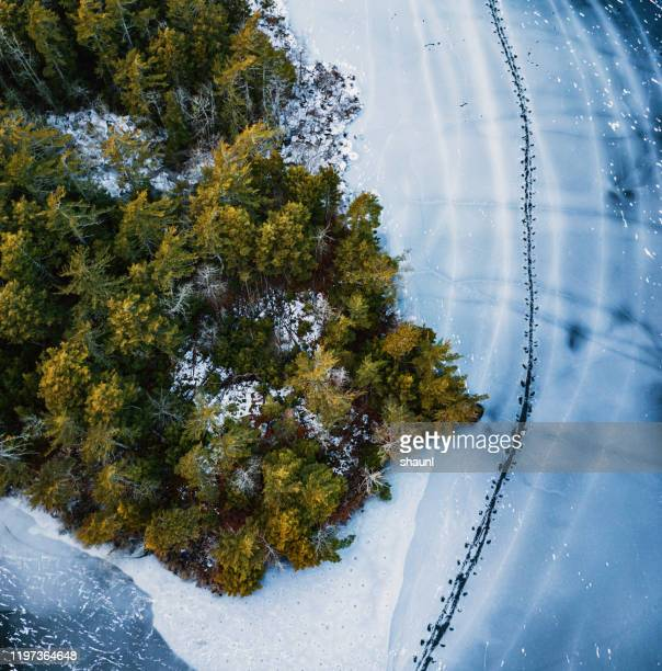 kayakers frozen path - pack ice stock pictures, royalty-free photos & images