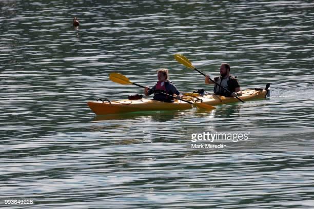 Kayakers in Akaroa harbour on Banks Peninsula