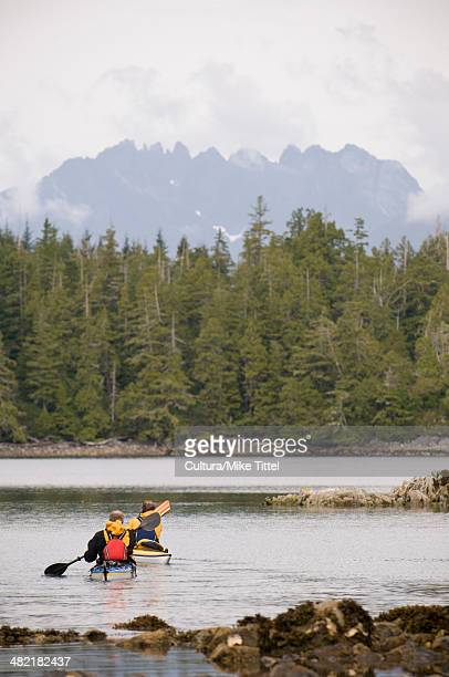 kayakers in rural lake - vancouver island stock pictures, royalty-free photos & images