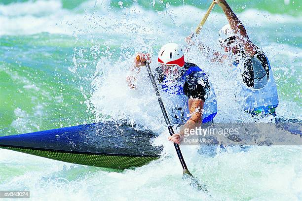 kayakers in whitewater - kajak stock-fotos und bilder