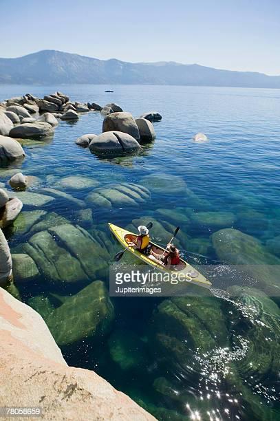 kayakers, lake tahoe, california - lake tahoe stock photos and pictures