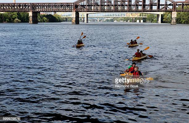 Kayakers makes their way up the Allegheny River in Pittsburgh Pennsylvania on August 25 2016