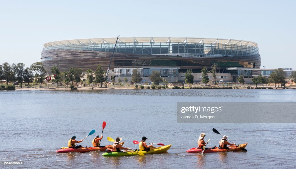 Kayakers on the Swan River beside the new Perth Stadium on March 17, 2017 in Perth, Australia. The WA Labor Party announced plans to sell off the naming rights of Perth Stadium and Perth Arena in order to boost the State's budget. The new stadium is currently under construction in the Perth suburb of Burswood.