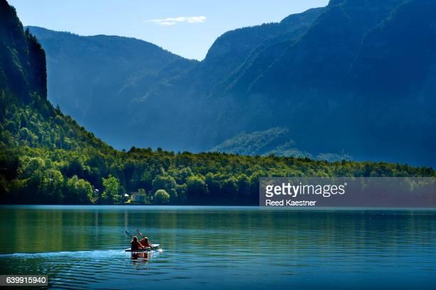 Kayakers paddle across Lake Hallstatt in Austria.