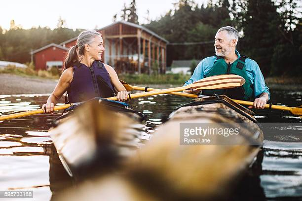 Kayaking Couple In The Pacific Northwest