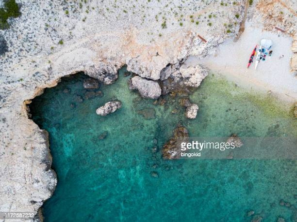 kayaking couple on beach from above - kayak stock pictures, royalty-free photos & images