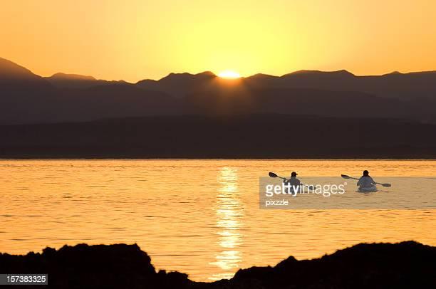 kayaking couple pacific sunset - baja california peninsula stock pictures, royalty-free photos & images
