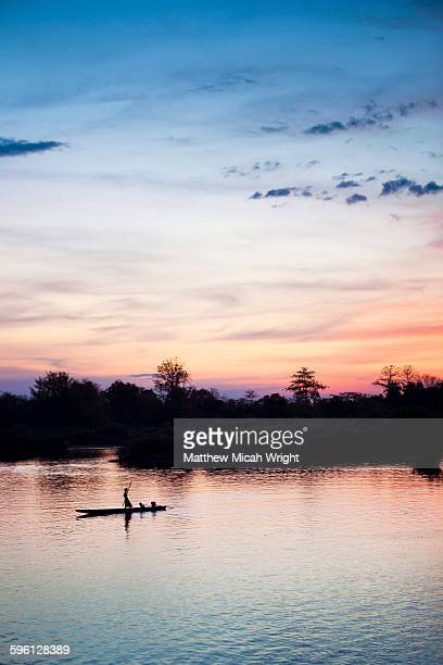 Kayaking down the Mekong river at sunset
