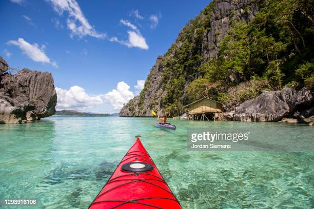 kayaking excursion in the philippines. - capital region stock pictures, royalty-free photos & images