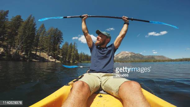 pov kayaking in lake recreational area - unusual angle stock pictures, royalty-free photos & images