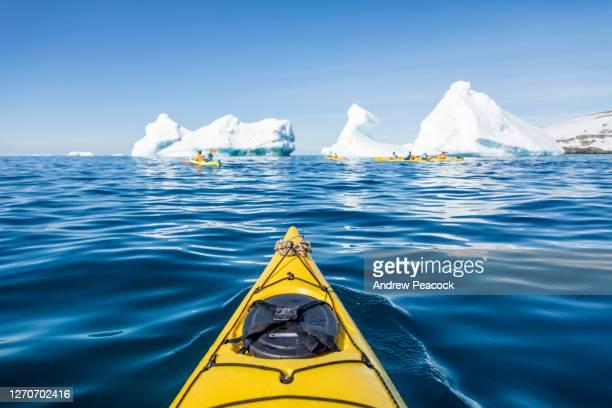 kayaking in terra nova bay, east antarctica - antarctica stock pictures, royalty-free photos & images