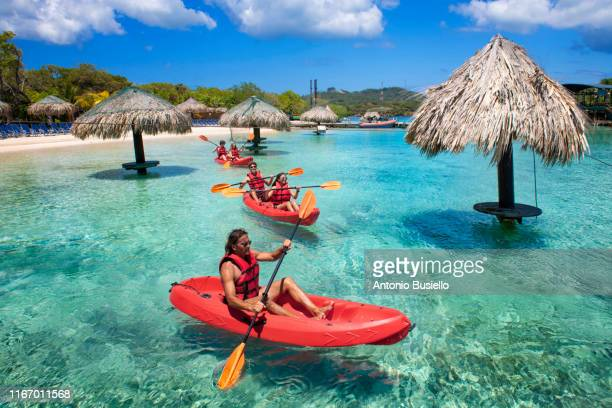 kayaking in the caribbean sea - caribbean stock pictures, royalty-free photos & images