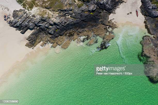 kayaking on coast, portree, uk - scotland stock pictures, royalty-free photos & images