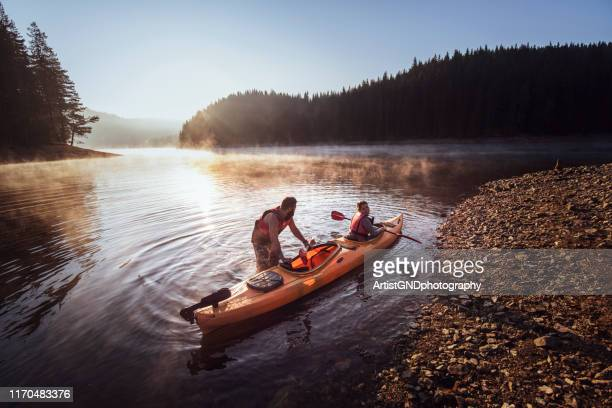 kayaking on mountain lake. - aquatic sport stock pictures, royalty-free photos & images
