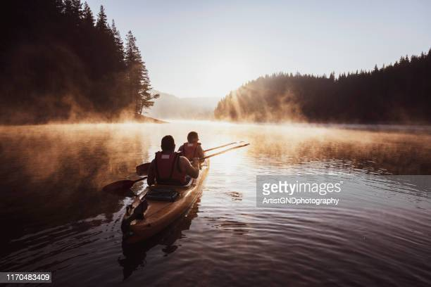 kayaking on mountain lake. - kayak stock pictures, royalty-free photos & images