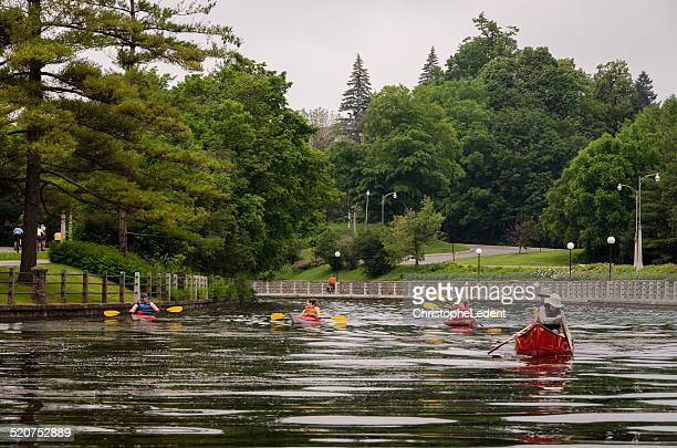 kayaking on ottawa's rideau canal (unesco world heritage site) - nautre stock pictures, royalty-free photos & images