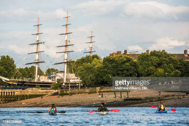 Kayaking on the River Thames by the Cutty Sark, Greenwich, London, England.