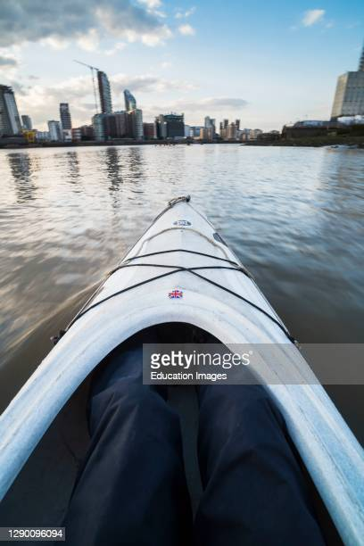 Kayaking on the River Thames, London, England.