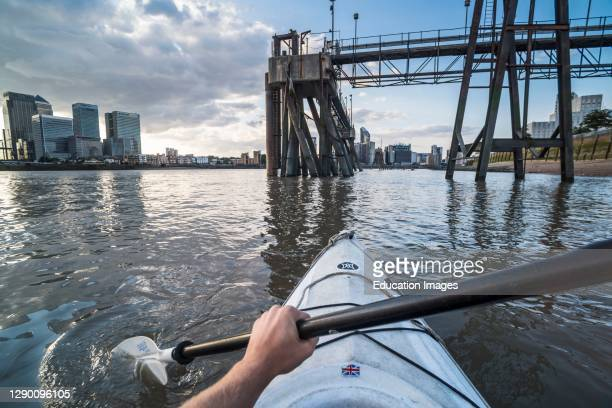 Kayaking on the River Thames, London, England.
