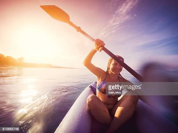 Kayaking on the sea at sunset