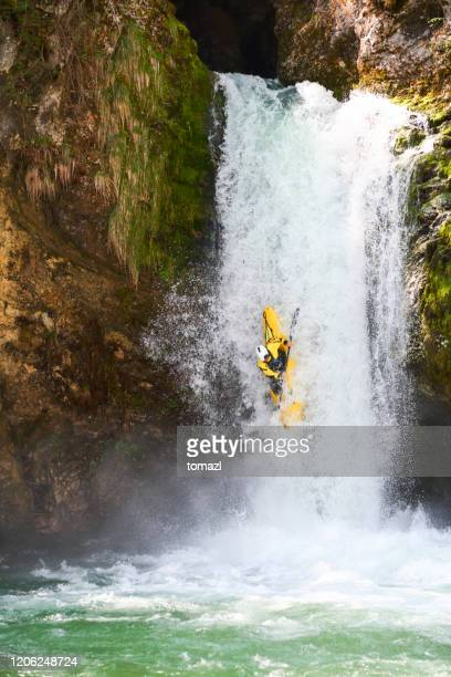 kayaking over big waterfall - water sport stock pictures, royalty-free photos & images