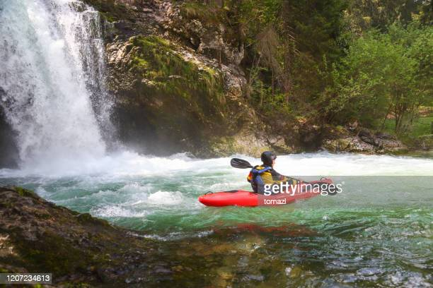 kayaking under a big waterfall - challenge stock pictures, royalty-free photos & images