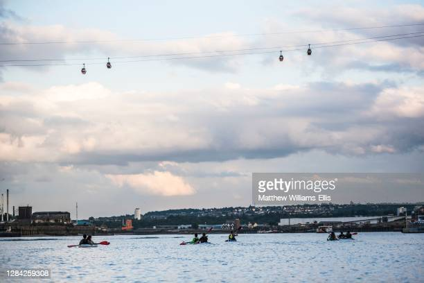 Kayaking under the Emirates Air Line Cable Car across the River Thames, Greenwich, London, England.