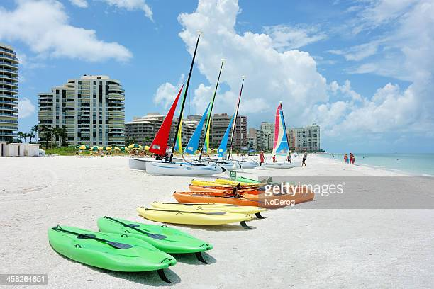 kayaks and hobie catamarans on beach - marco island stock pictures, royalty-free photos & images