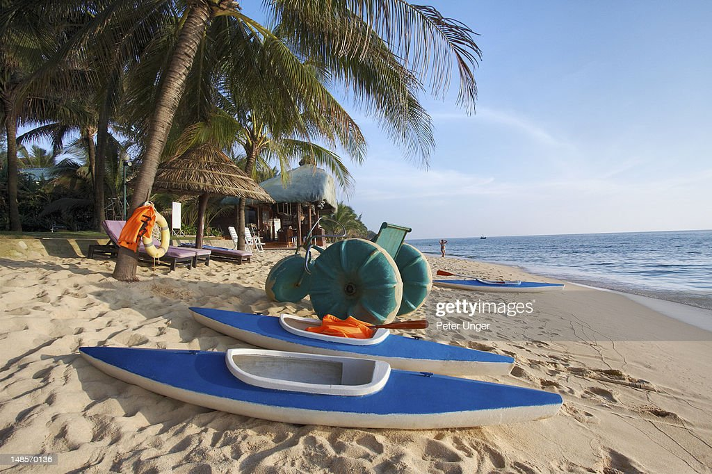 Kayaks And Water Bicycle On Long Beach Stock Photo