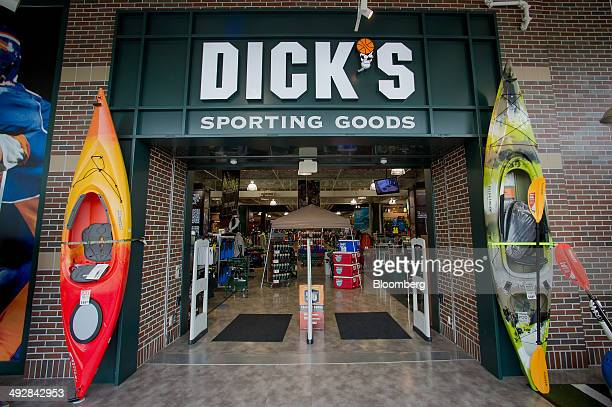 Kayaks are displayed outside of a Dick's Sporting Goods Inc store in West Nyack New York US on Wednesday May 21 2014 Dick's Sporting Goods Inc shares...