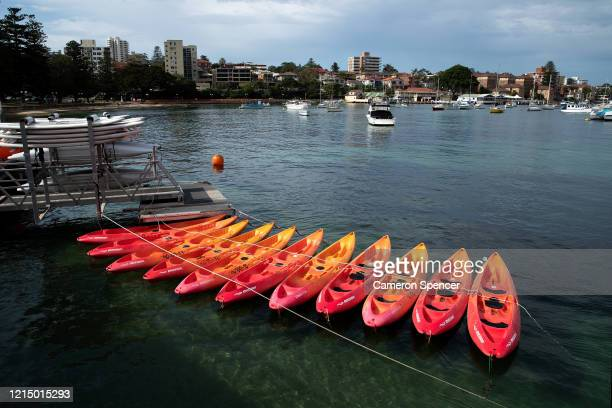 Kayaks are seen tied up at a kayak hire venue at Manly Wharf on March 25 2020 in Sydney Australia The state of New South Wales in Australia has the...