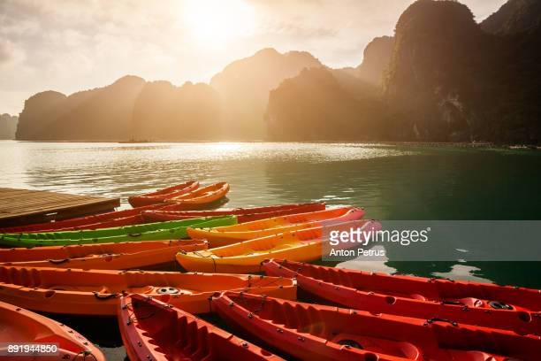 kayaks at sunset in halong bay, vietnam - hanoi stock pictures, royalty-free photos & images