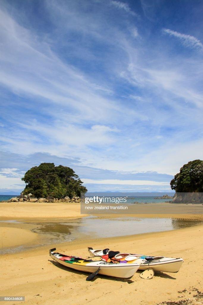 Kayaks on the beach, Mosquito Bay, Abel Tasman National Park, New Zealand : Stock Photo