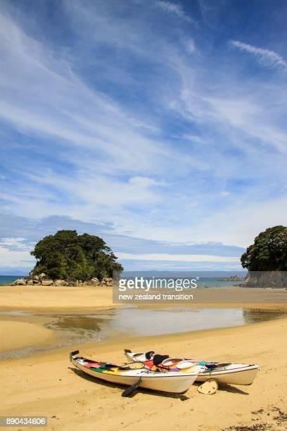 Kayaks on the beach, Mosquito Bay, Abel Tasman National Park, New Zealand
