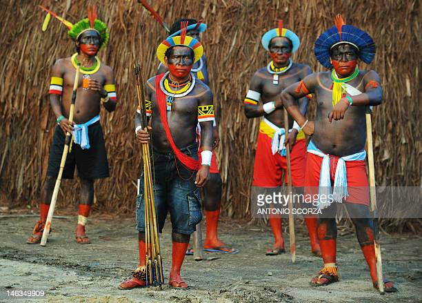 Kayapo indians stand by to take part in the green games at the KariOca indian village on June 14 2012 as part of the UN Rio20 environmental summit in...