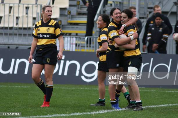 KayaRose Kahui of Taranaki hugs team mate Alesha Williams after a try scored during the round 3 Farah Palmer Cup match between Taranaki and Tasman at...